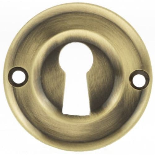 Old English Pair Of Open Key Escutcheon On Round Rose In Antique Brass